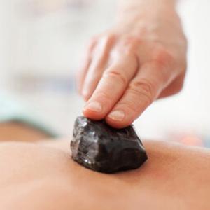 Hot stone massage - Upplevelse presenter